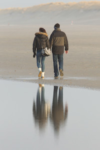 Couple walking on a dutch beach